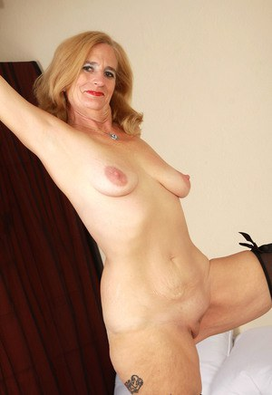 Older woman Ray Lynn parts her labia lips in lace gloves and nylons