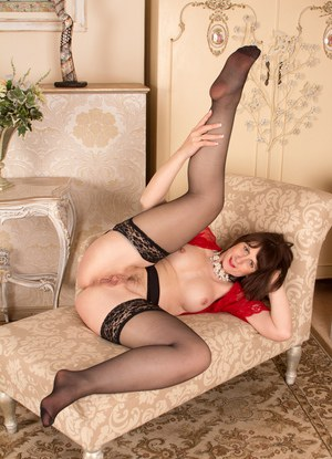 Stocking and lingerie adorned mature brunette exposing big natural tits