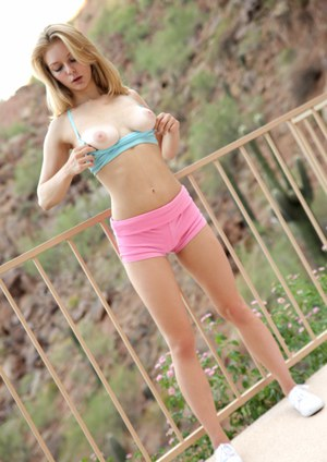 Cute blonde teen Alli Rae masturbates on outdoor stairs