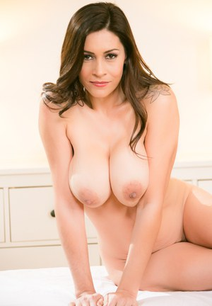 Latina masseuse Raylene uncovers her nice tits as she gets naked