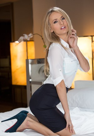 ... Clothed blonde babe sliding skirt over long legs in high heels ...