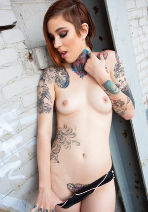 Tattooed alt chick in schoolgirl socks and outfit baring tiny tits