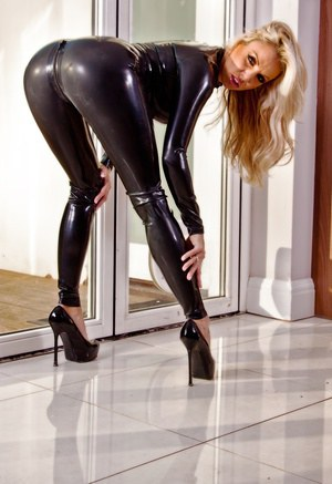 Hot MILF pornstar in latex catsuit and heels flaunting her sexy ass