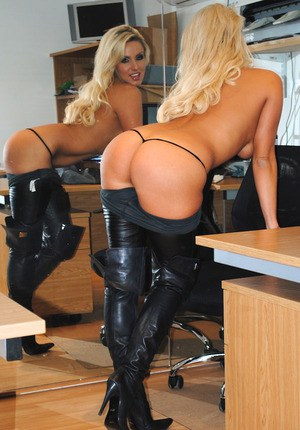 Hot blonde Dannii Harwood strips to her boots on her bosses desk for kicks