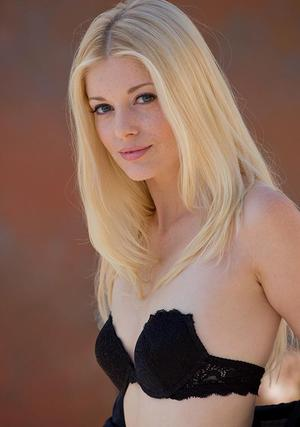 Blond babe Charlotte Stokely exhibiting tiny tits and sexy ass in stockings