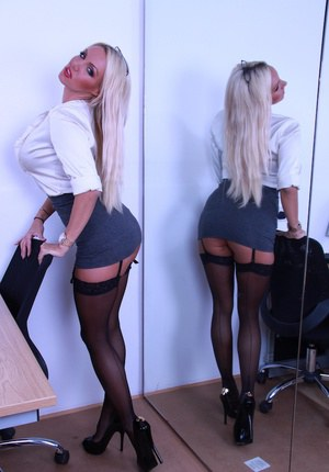 Attractive big ass secretary Dannii Harwood gets horny at the office
