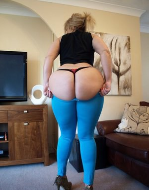 Mature BBW Daniella English frees her bush from yoga pants and thong panties