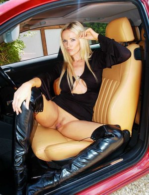 Hot blonde chick Lucy Zara flashes a no oanty upskirt in a sports car