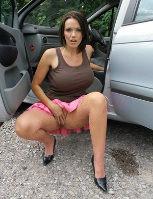 Brunette MILF Lucy Zara flashes nude upskirt in the car & masturbates