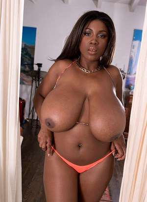 Black BBW Maserati reveals her huge tits and big butt as she strips to a thong