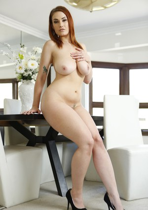 Curvy redhead finishes off a fuck session with a titty fuck