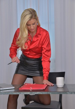 Hot blonde office worker sheds leather skirt to show bald beaver at the office