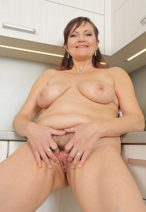 Hot mature Justina enjoys nipples with her tea  fingers in the kitchen