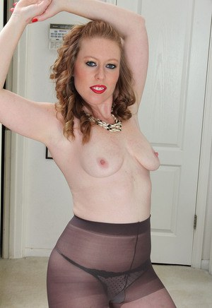 Beautiful mature Amber Carlisle with saggy tits on her knees naked  spreading