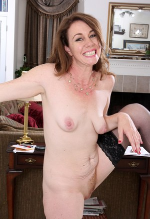 Smiley mature mom Molly Golly flaunts tiny saggy boobs spreads small ass