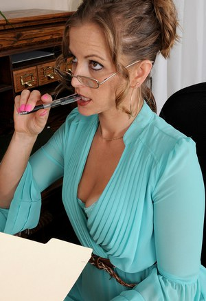 Over-30 female Melissa Rose takes off her glasses and strips at writing desk