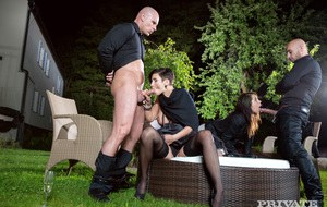 Swinging females Gabrielle Gucci and Ferrera Gomez have a foursome outdoors
