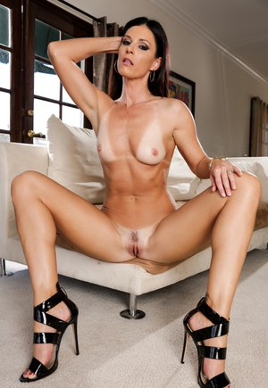 Brunette solo model India Summer pets her pussy after removing clothes