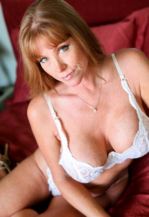 Hot mature bombshell Darla teases with her big tits in white lingerie