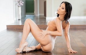 Asian solo girl Asa Akira does a striptease before posing in the nude
