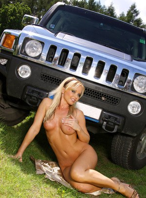 Gorgeous blonde chick Silvia Saint models naked in front of a 4 x 4 vehicle