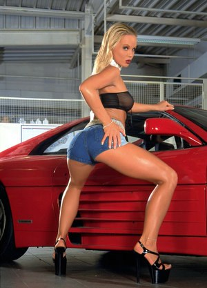 Hot pornstar Silvia Saint flaunts long legs in shorts & high heels by her car