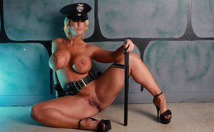 Policewoman Alura Jenson flaunts her huge boobs while posing in her cop hat