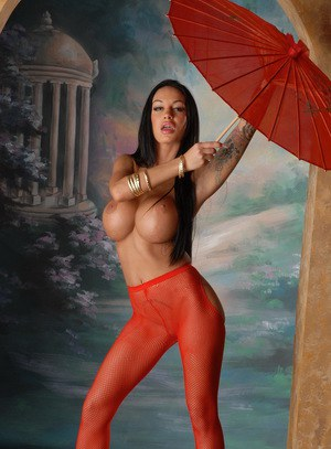Hot pornstar Angelina Valentine in red pantyhose toying ass with parasol