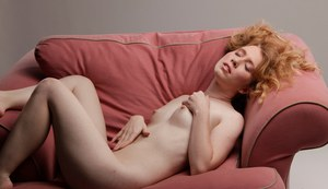 Pale redhead Nicki Blue shows off flexibility during nude masturbation action