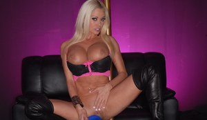 Platinum blonde female Nikita Von James toys her bald pussy in OTK boots
