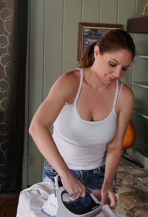 39 year old abd busty Kiki D'Aire slips off her denim shorts for you