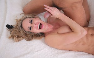 Busty blonde Brandi Love submits to an Asian male in black corset and gloves
