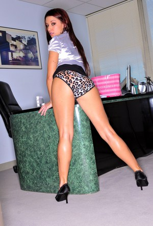 Sexy Latina office girl Ann Marie Rios lifts short skirt to show hot ass