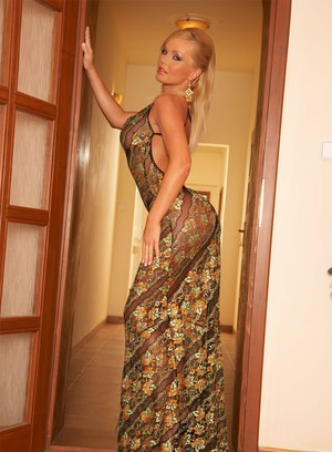 Sexy mature lady Silvia poses erotically in a classy see-through dress