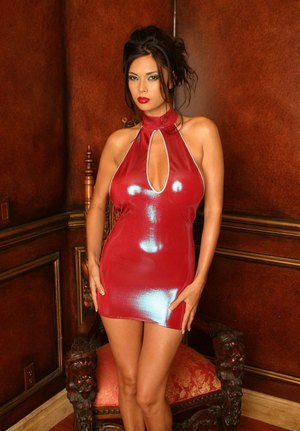 Top Asian pornstar Tera Patrick hikes up her latex dress to insert a sex toy