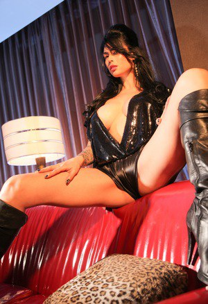 Hot Asian chick Tera Patrick spreads her legs in leather panties and boots