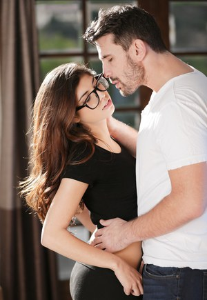 Bespectacled brunette honey Ava lets a hung stud grope her tiny tits