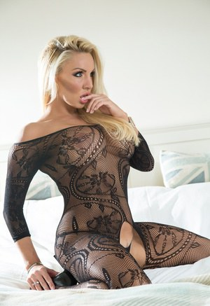 Blonde goddess Dannii Harwood poses on bed in crotch and assless bodystocking