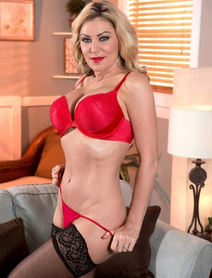 Middle-aged blonde Sasha Sean flaunts her big tits after undressing