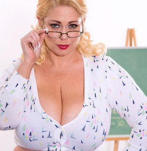 Sexy fat teacher Samantha treats her student to a glimpse of her 38G boobs