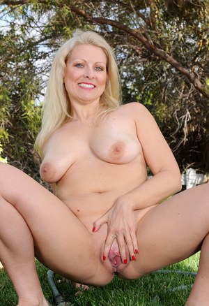 Sexy mature blonde Zoey Tyler in hot pink underwear spreads pussy lips outside