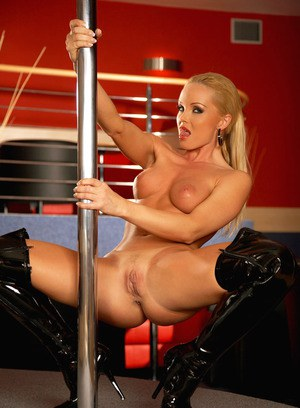 Busty blonde Silvia Saint in hot lingerie doing striptease in high heels boots
