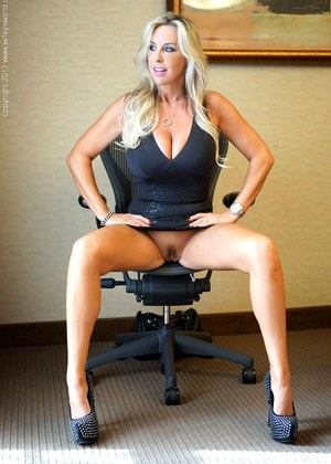 Hot wife with long blonde hair exposes her upskirt pussy in conference room