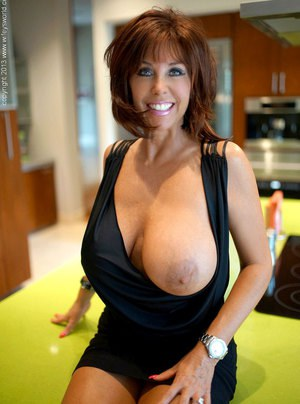 Hot housewife with nice melons coaxes the jizz from her mans dick