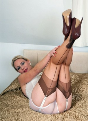 Mature lady Tiffany T shows her sexy feet in stockings and toys herself