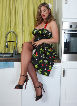 Housewife Jenny Badeau strips off her retro dress and lingerie in the kitchen