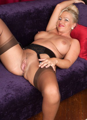 Mature vintage model Taylor Morgan licks her big boobs while spreading pussy
