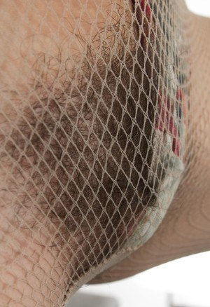 Dark haired amateur Anissa removes mesh bodystocking to air out her hairy muff