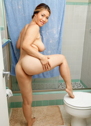 Big titted Asian housewife grabs her bare ass while taking a shower