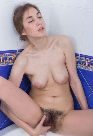 Nasty girl Halmia gladly shows off her puffy nipples and a furry twat